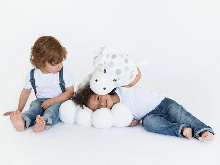Photo of kids snuggling plush toy